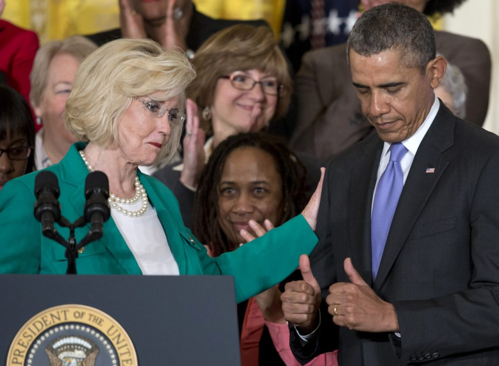 President Barack Obama gives two thumbs as Women's rights activist Lilly Ledbetter acknowledges him during an event marking Equal Pay Day. (Carolyn Kaster/AP)