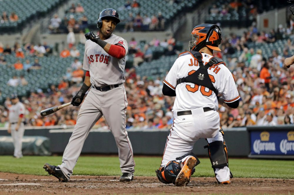 Boston Red Sox's Jonathan Herrera, left, reacts in front of Baltimore Orioles catcher Caleb Joseph after striking out swinging in the third inning. (AP/Patrick Semansky)
