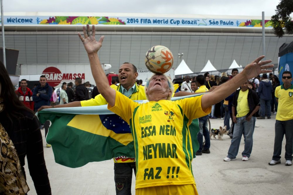 A man performs outside Arena Corinthians stadium in Sao Paulo. (Rodrigo Abd/AP)
