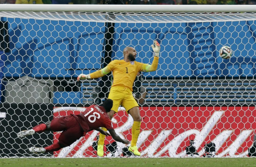 Portugal's Silvestre Varela heads the ball past United States' goalkeeper Tim Howard to score his side's second goal and tie the game 2-2. (Martin Mejia/AP)