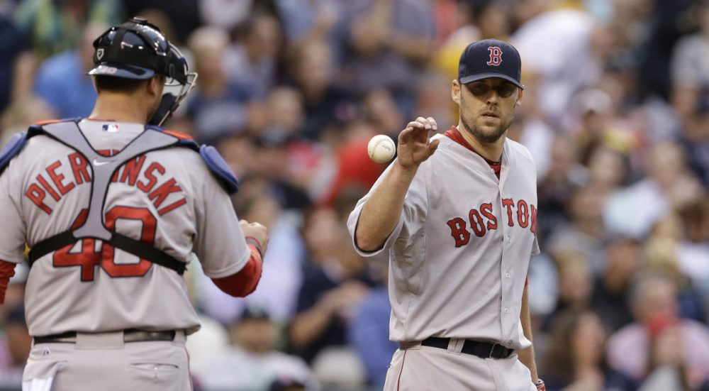 Red Sox starting pitcher John Lackey gets the ball back from catcher A.J. Pierzynski after giving up a run to the Seattle Mariners in a  game Monday, June 23, 2014, in Seattle. (Elaine Thompson/AP)