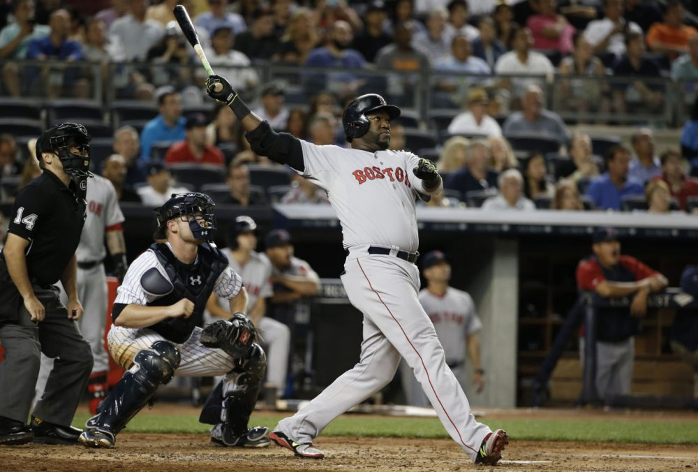 Boston Red Sox designated hitter David Ortiz hits a third-inning, three-run home run off New York Yankees starting pitcher Chase Whitley. (AP/Kathy Willens)