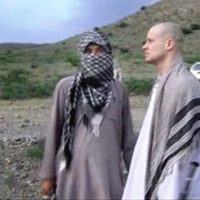 In this image taken from video obtained from Voice Of Jihad Website, which has been authenticated based on its contents and other AP reporting, Sgt. Bowe Bergdahl, right, stands with a Taliban fighter in eastern Afghanistan. The Taliban on Wednesday, June 4, 2014, released a video showing the handover of Bergdahl to U.S. forces in eastern Afghanistan, touting the swap of the American soldier for five Taliban detainees from Guantanamo as a significant achievement for the insurgents. (AP)