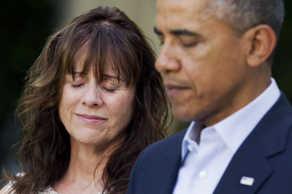 Jani Bergdahl, mother of U.S. Army Sgt. Bowe Bergdahl, reacts as President Barack Obama speaks about the release of her son, during a news conference in the Rose Garden of the White House in Washington on Saturday.(AP PHOTO)