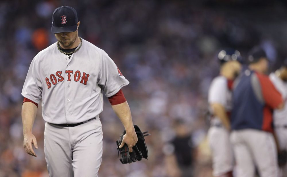 Boston Red Sox starting pitcher Jon Lester leaves after being pulled from the baseball game against the Detroit Tigers during the fifth inning in Detroit, Saturday, June 7, 2014. (Carlos Osorio/AP)