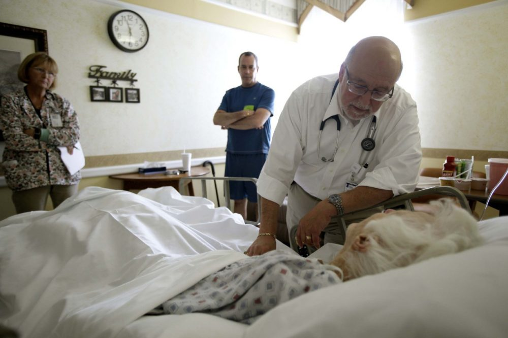 In this 2009 file photo, Dr. Joel Policzer checks on Lillian Landry in the hospice wing of an Oakland Park, Florida, hospital. Unlike most of Policzer's patients she made end-of-life decisions. (AP)