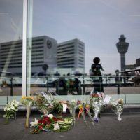 Floral tributes adorn the entrance to Amsterdam's Schiphol Airport memory of the victims of Air Malaysia flight MH17 on July 18, 2014. Air Malaysia flight MH17 travelling from Amsterdam to Kuala Lumpur crashed yesterday on the Ukraine/Russia border near the town of Shaktersk. The Boeing 777 was carrying 298 people including crew members, the majority of the passengers being Dutch nationals, believed to be at least 173, 44 Malaysians, 27 Australians, 12 Indonesians and 9 Britons. (Christopher Furlong/Getty Images)