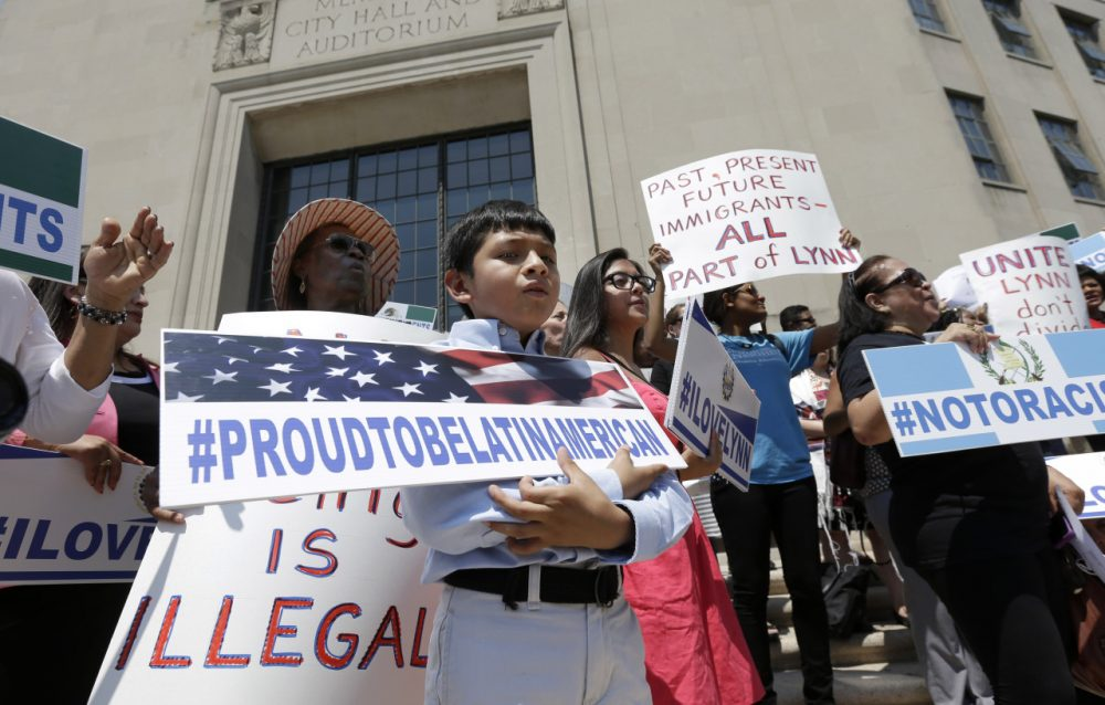 Christian Gonzalez, 9, of Lynn, Mass., displays a placard during a rally, Tuesday, July 22, 2014, on the steps of City Hall, in Lynn, held to protest what organizers describe as the scapegoating of immigrants for problems in the city. The mayor of Lynn and education officials complain their schools are being overwhelmed by young Guatemalans who speak neither English or Spanish as their first language. Gonzalez, a U.S. citizen, was born in Boston. (AP)