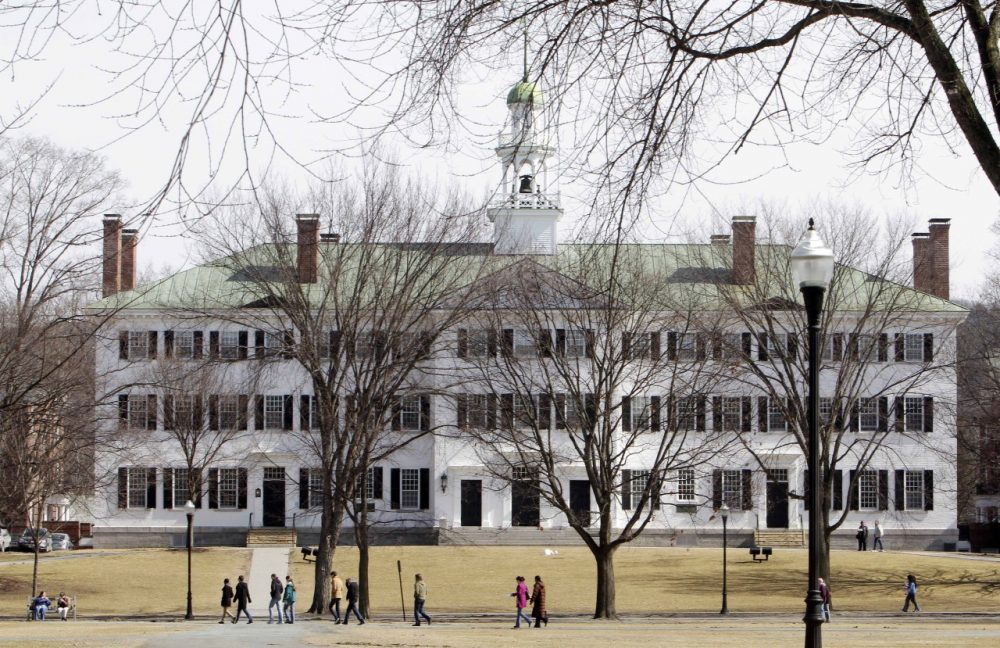 In this photo taken Monday March 12, 2012, students walk across the Dartmouth College campus green in Hanover, N.H.  (AP)