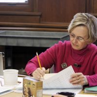 Debra Chermonte, dean of admissions at Oberlin College, goes through applications at the college in Oberlin, Ohio, Nov. 19, 2010. (Gary Cohen/Oberlin College via AP)