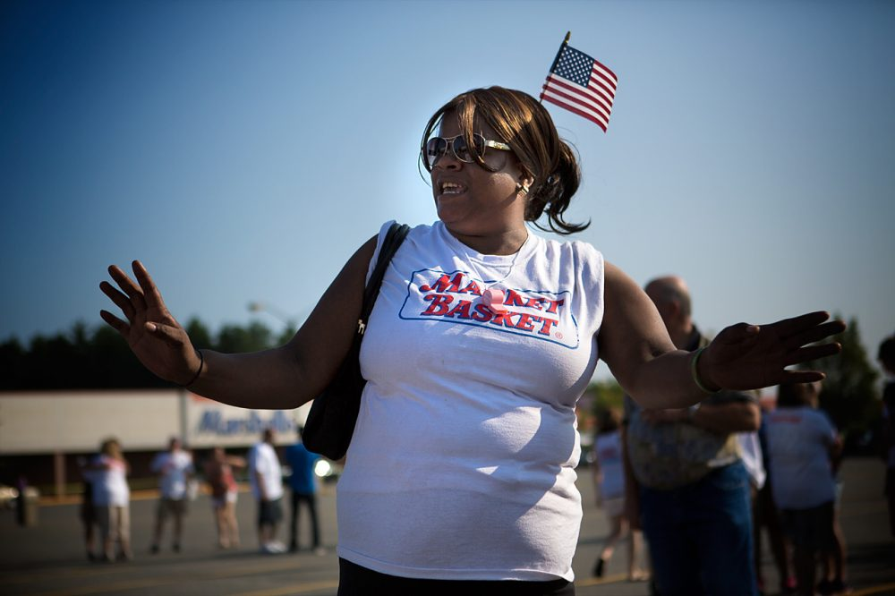 Market Basket employees rally in Tewksbury on Tuesday. (Jesse Costa/WBUR)