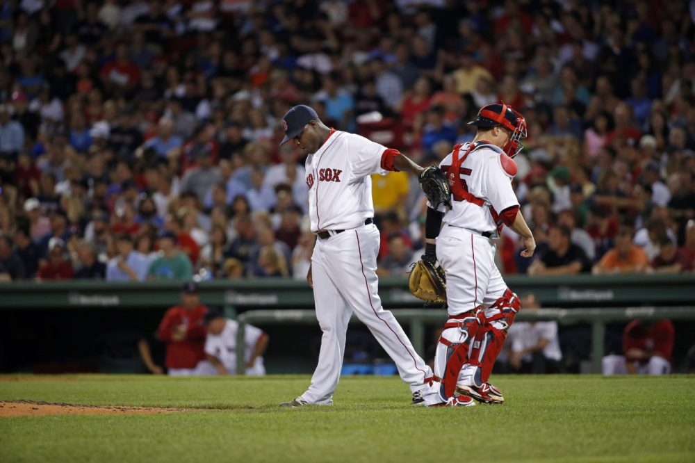 Red Sox starting pitcher Rubby De La Rosa pats Boston Red Sox catcher Christian Vazquez. (AP/Elise Amendola)