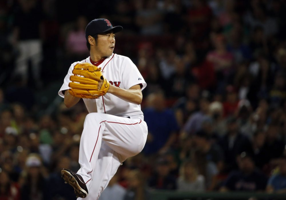 Boston Red Sox relief pitcher Koji Uehara pitches. (AP/Elise Amendola)