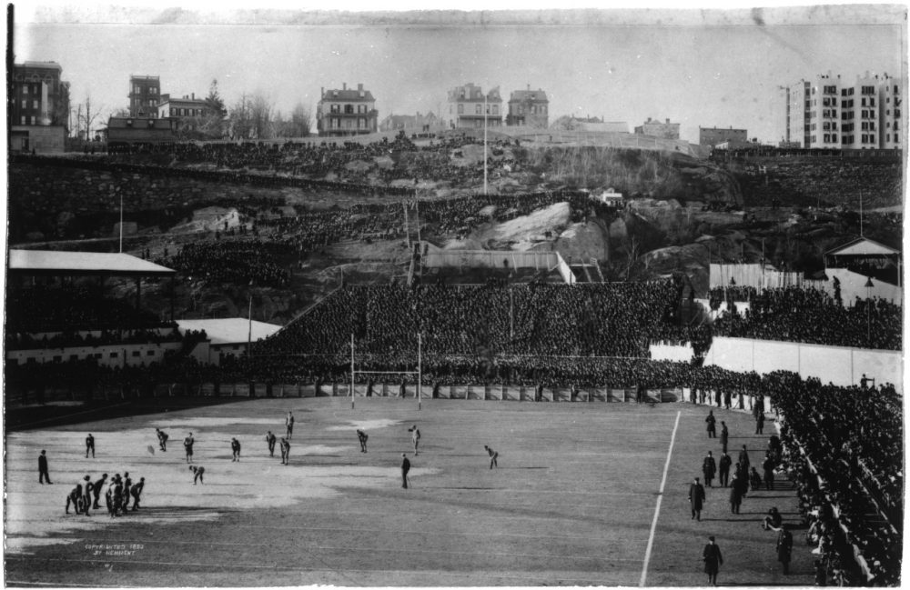With 50,000 fans watching, Princeton's Phil King places the ball at midfield to begin the 1893 game against Yale.  The Tigers are aligned in a flying wedge. (Courtesy of Manuscripts and Archives, Yale University Library)