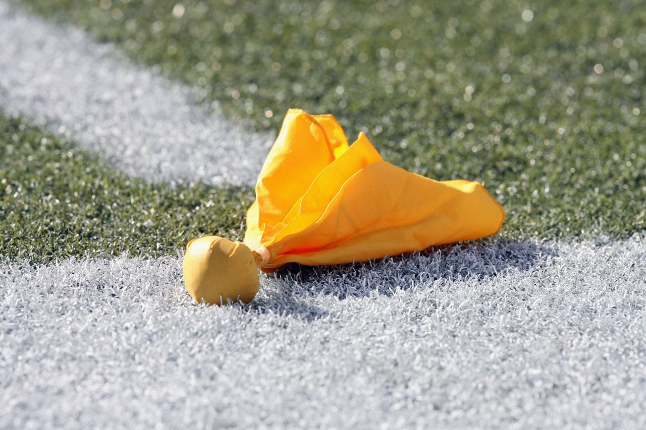 Penalty flag lying on playing field