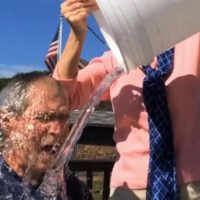 In this image from video posted on Facebook, courtesy of the George W. Bush Presidential Center, former President George W. Bush participates in the ice bucket challenge with the help of his wife, Laura Bush, in Kennebunkport, Maine. (AP)