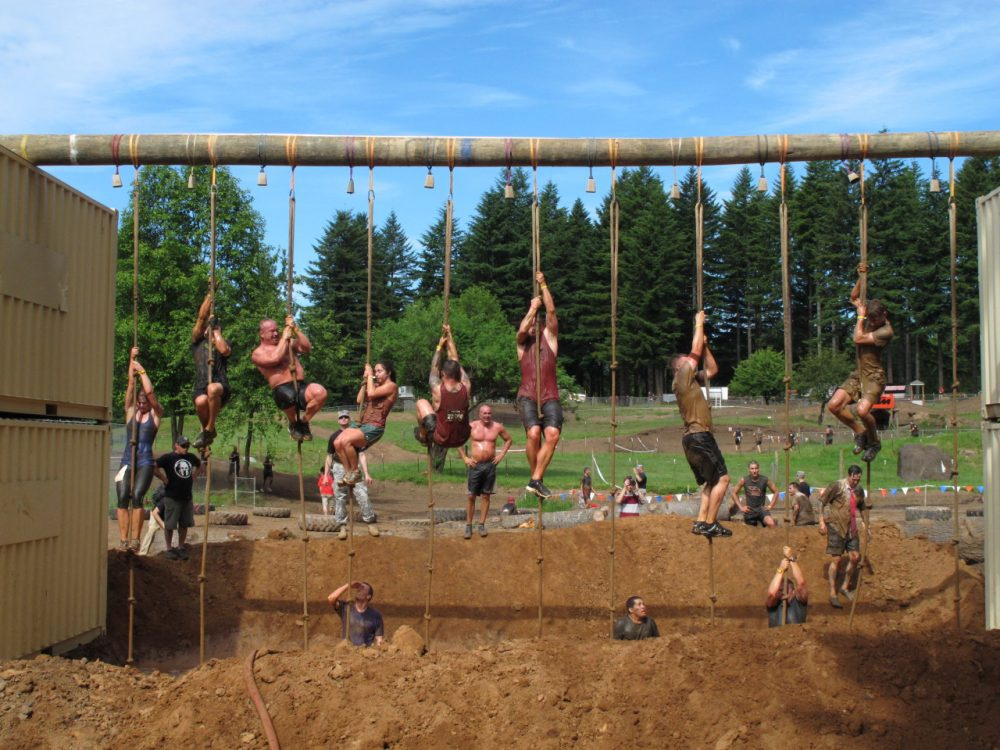 "Competitors tackle an obstacle during the Pacific Northwest ""Spartan Sprint"" on Saturday, June 16, 2012, in Washougal, Wash.(AP/Rachel La Corte)"