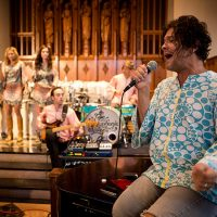 The Polyphonic Spree perform at the Marsh Chapel at Boston University. (Jesse Costa/WBUR)