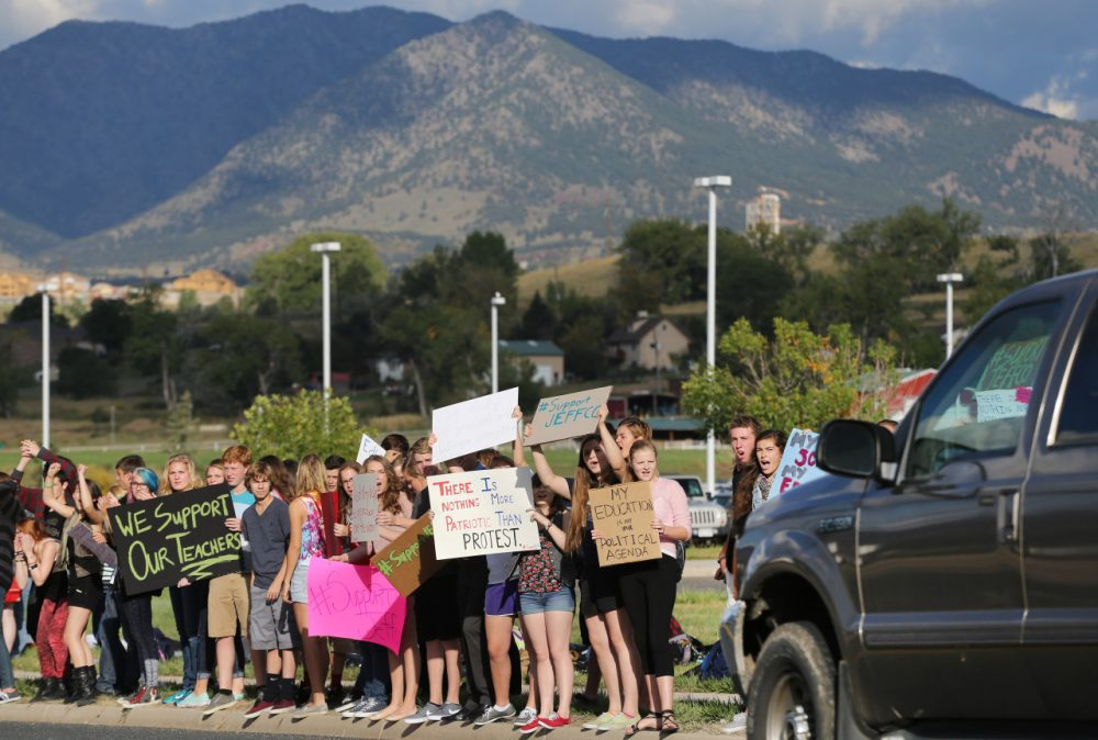 Students protest a proposal by the Jefferson County School Board to emphasize patriotism and downplay civil unrest in the teaching of U.S. history on Sept. 23, 2014. (Brennan Linsley/AP)