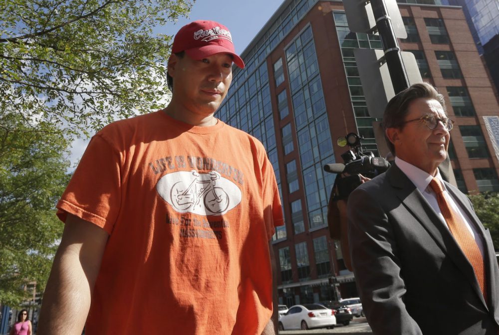 Glenn Adam Chin, seen here on the left with his lawyer after an appearance in federal court in Boston last week, is the first person arrested in connection with a deadly meningitis outbreak linked to a Framingham compounding pharmacy. (Steven Senne/AP)