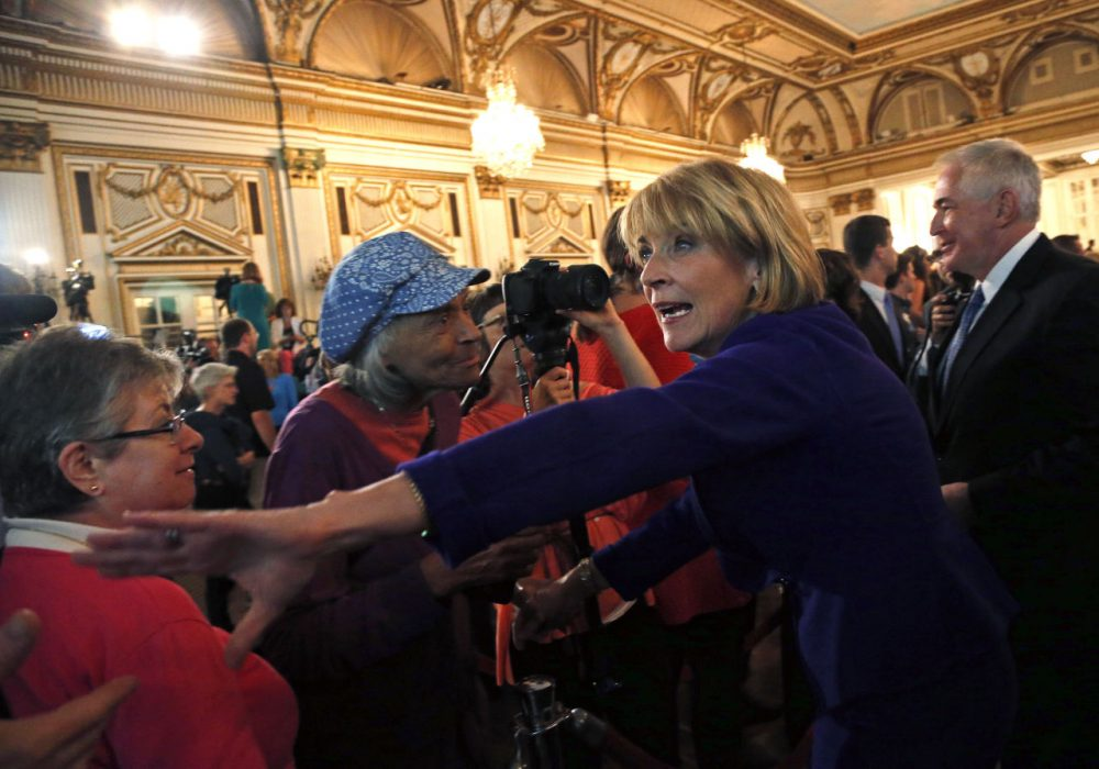 Martha Coakley greets supporters after delivering her victory speech in the Democratic gubernatorial primary Tuesday. (Elise Amendola/AP)