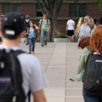 Students walk through the UMass Amherst campus. (Andrew Phelps/WBUR)