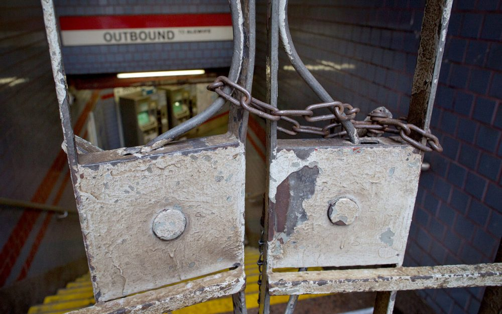 The entrance to the Central Square Red Line station was chained closed Tuesday as the MBTA suspended all rail service following Monday's storm. (Robin Lubbock/WBUR)