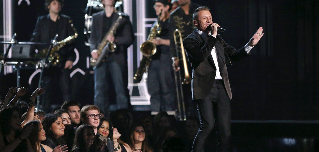 Macklemore performs at the 56th annual Grammy Awards at Staples Center in Los Angeles on Sunday, Jan. 26, 2014. (Matt Sayles/Invision/AP)