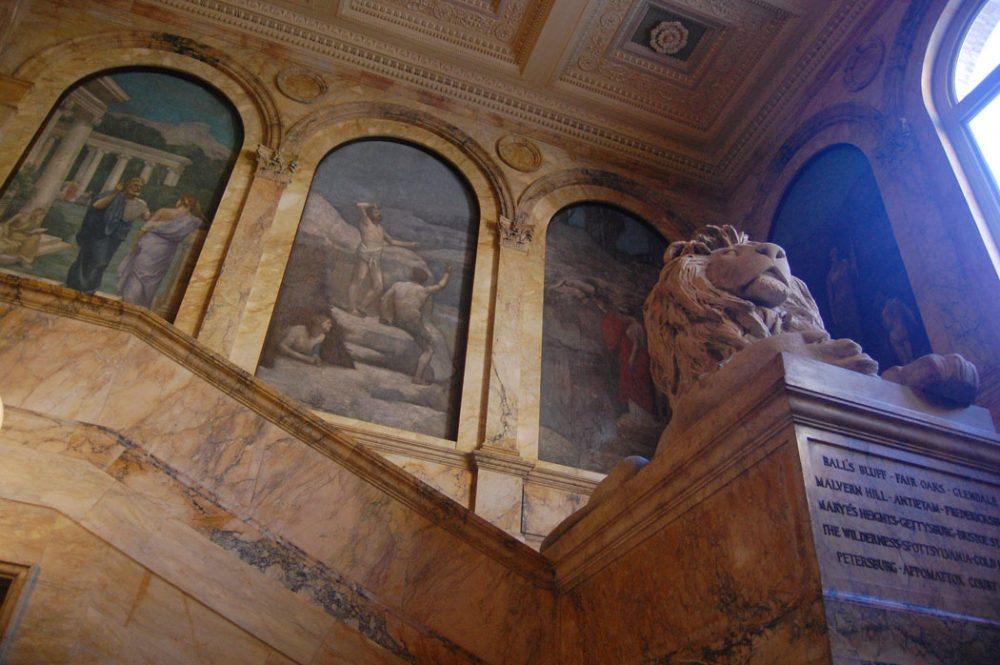 Lions—monuments to the Civil War—flank the main stairway in the 1895 McKim Building. (Greg Cook)