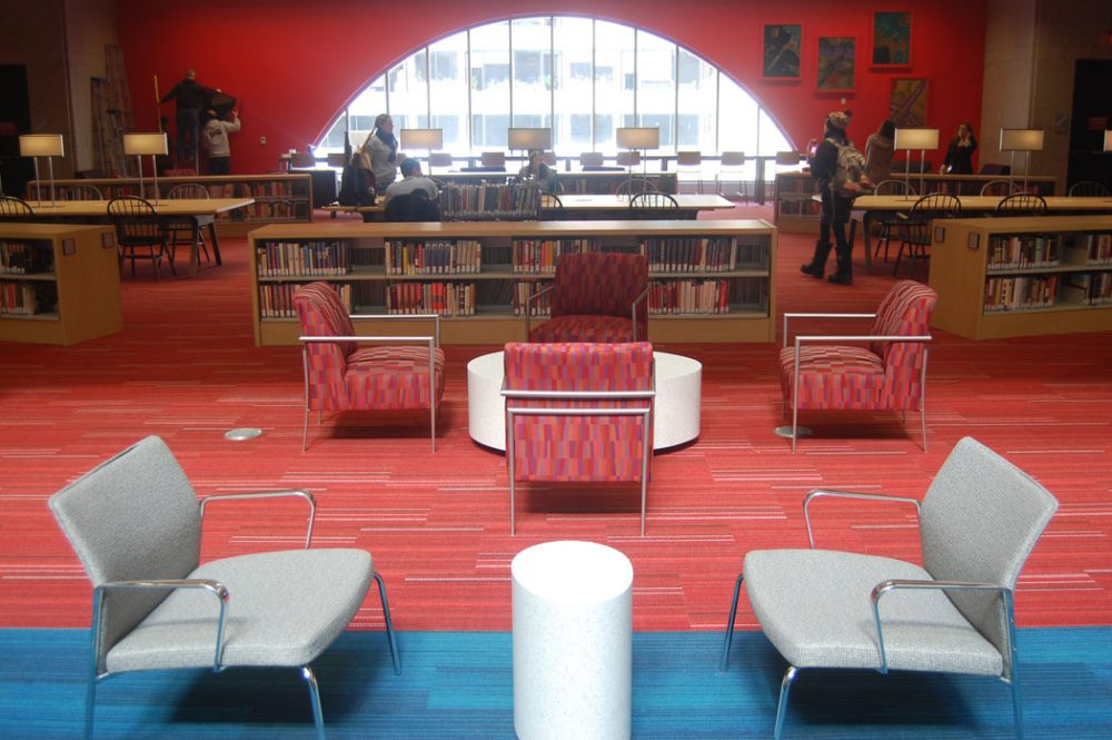 """In the original design, there were no windows in this building. They were added afterwards. When they were added, they were all tinted glass. They've been replaced with clear glass,"" Colford says. Pictured here is a new seating area facing Boylston Street. ""We had four main goals for the project and one of them was to connect the library with the street."" (Greg Cook)"
