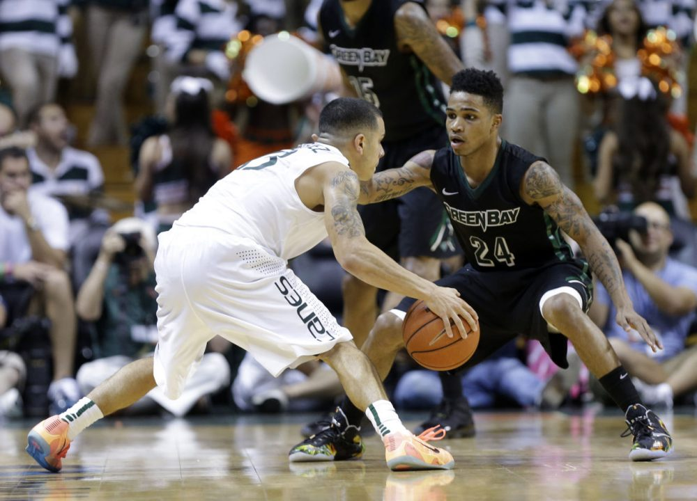 Green Bay's Keifer Sykes (right) is an NBA prospect -- and a father. (Lynne Sladky/AP)