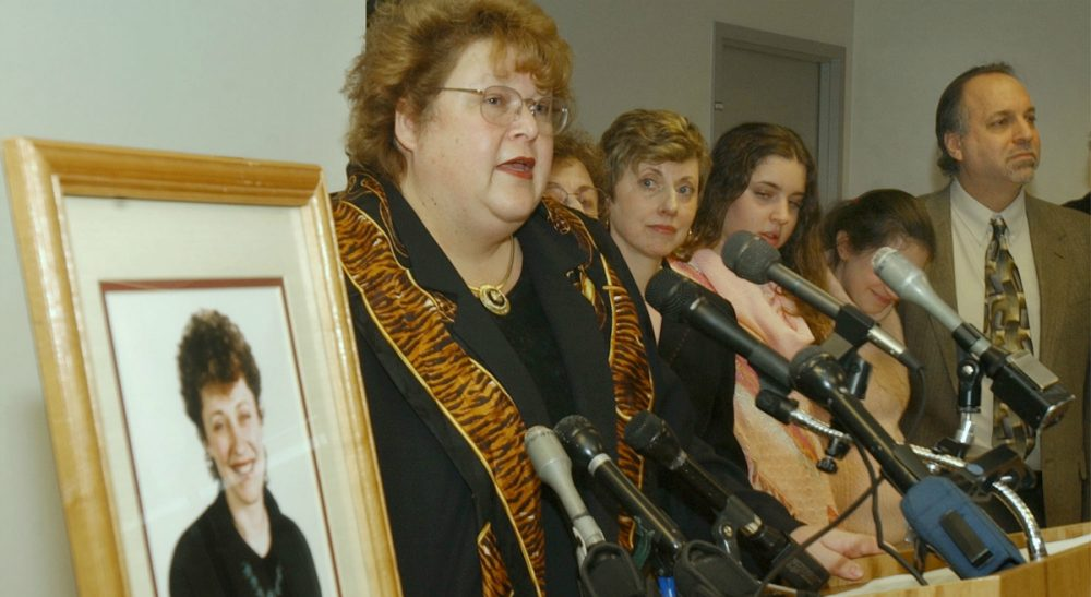 Massachusetts Department of Public Health Commissioner Christy Ferguson stands by late Boston Globe reporter Betsy Lehman's photo while she announces the creation of the Betsy Lehman Center for Patient Safety and Medical Error Prevention in 2004. (Chitose Suzuki/AP)