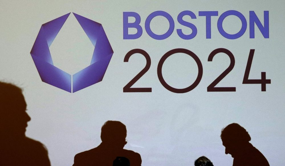 The Boston 2024 logo is displayed on a screen before a January news conference about the bid. (Charles Krupa/AP)