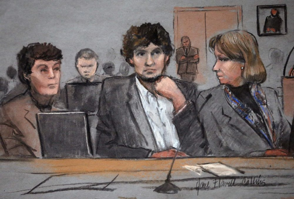 In this courtroom sketch, Dzhokhar Tsarnaev, center, is depicted between defense attorneys Miriam Conrad, left, and Judy Clarke, right, during his federal death penalty trial Thursday. (Jane Flavell Collins/AP)