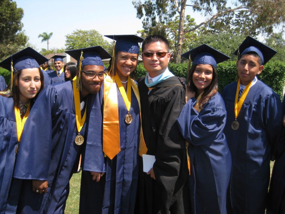 Tommy Chang will begin as superintendent on July 1. Here he is with students at a graduation ceremony at Ánimo Venice Charter High School, part of the Los Angeles Unified School District. (Courtesy of LAUSD)
