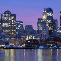 Olympic city? Boston's skyline is illuminated at dusk as it reflects off the waters of Boston Harbor. Ahead of a 2017 vote by the International Olympic Committee to select a host city for the 2024 Summer Games, Massachusetts voters will have the chance to make their voices heard in an important vote about paying for the Olympics. Former gubernatorial candidate Evan Falchuk offers a primer to what that vote would mean, why it's different from a referendum, and why voters should care. (Michael Dwyer/AP)