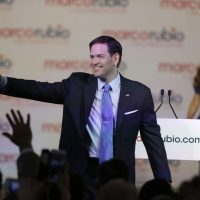 Florida Sen. Marco Rubio waves to supporters as his wife Jeanette joins him on stage, after he announced that he will be running for the Republican presidential nomination, during a rally at the Freedom Tower, Monday, April 13, 2015, in Miami. (AP)
