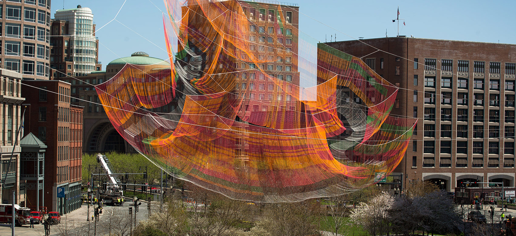 Janet Echelman's aerial sculpture takes shape over the Rose Kennedy Greenway in Boston. (Robin Lubbock/WBUR)