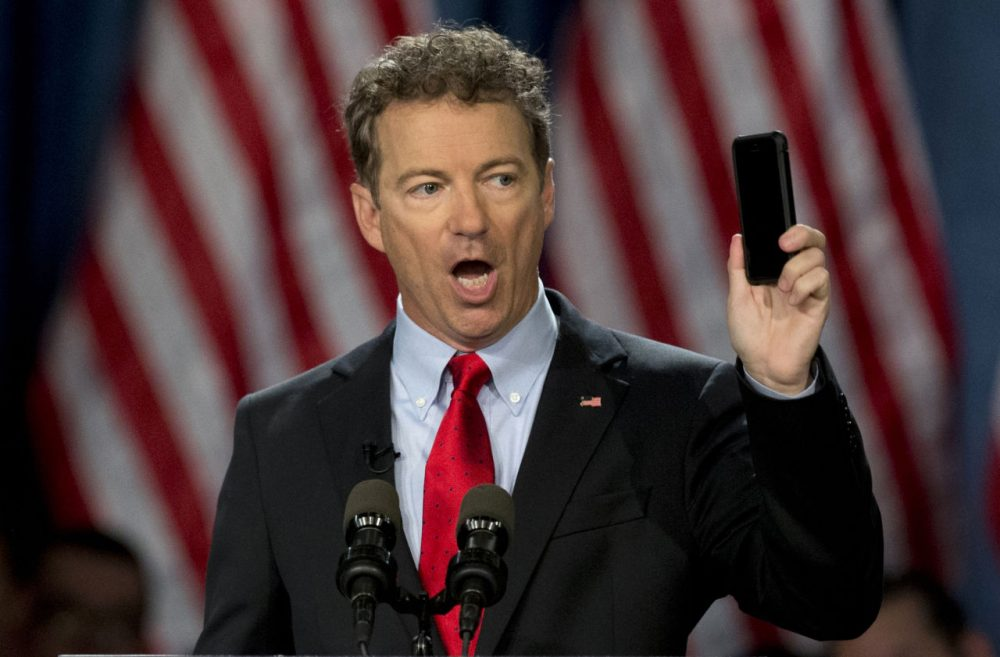Sen. Rand Paul holds up his cell phone as he speaks before announcing the start of his presidential campaign, in Louisville, Ky. (Carolyn Kaster/AP)