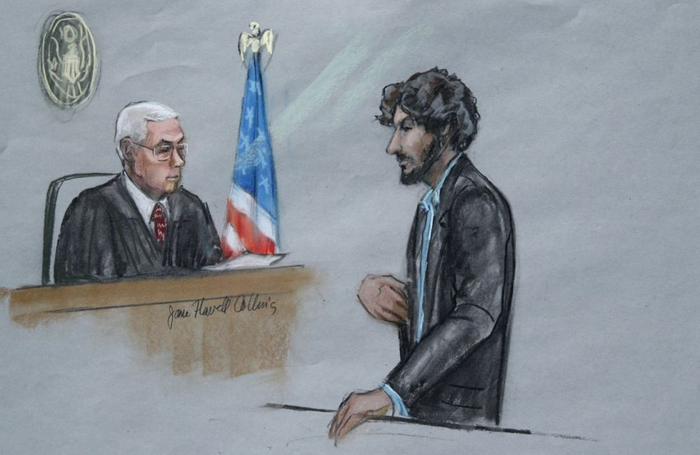 In this courtroom sketch, Boston Marathon bomber Dzhokhar Tsarnaev stands before U.S. District Judge George O'Toole Jr. as he addresses the court during his sentencing. Tsarnaev apologized to the victims and their loved ones for the first time, just before the judge formally sentenced him to death. (Jane Flavell Collins/AP)