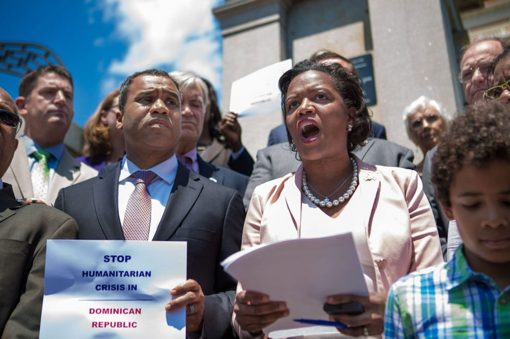 State Sen. Linda Dorcena Forry stands on the steps of the State House Wednesday calling for a boycott of the Dominican Republic to protest that country's threatened expulsion of Haitians. (Jesse Costa/WBUR)