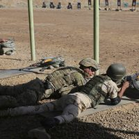 In this file photo, A U.S. soldier trains an Iraqi security forces member in a shooting drill in Taji, north of Baghdad, Iraq, Saturday, March 21, 2015.  (AP)