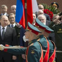Russian President Vladimir Putin, left, takes part in a wreath laying ceremony at the Tomb of the Unknown Soldier outside Moscow's Kremlin Wall, in Moscow, Russia, Monday, June 22, 2015, to mark the 74th anniversary of the Nazi invasion of the Soviet Union. (AP)