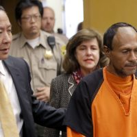 Juan Francisco Lopez-Sanchez, right, is led into the courtroom on Tuesday, July 7, 2015, for his arraignment at the Hall of Justice in San Francisco for the killing of a 32-year old San Francisco woman. Lopez-Sanchez was released from jail in April, even though immigration officials had lodged a detainer to try to deport him from the country for a sixth time. (Michael Macor/San Francisco Chronicle/AP)