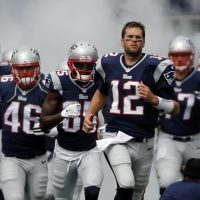 If you'd never let your own son play, but you're perfectly fine watching someone else's kid get thrashed, you're part of the problem. In this photo, New England Patriots quarterback Tom Brady leads his teammates onto the field before a game on Sunday, Sept. 21, 2014, in Foxborough, Mass. (Elise Amendola/ AP)