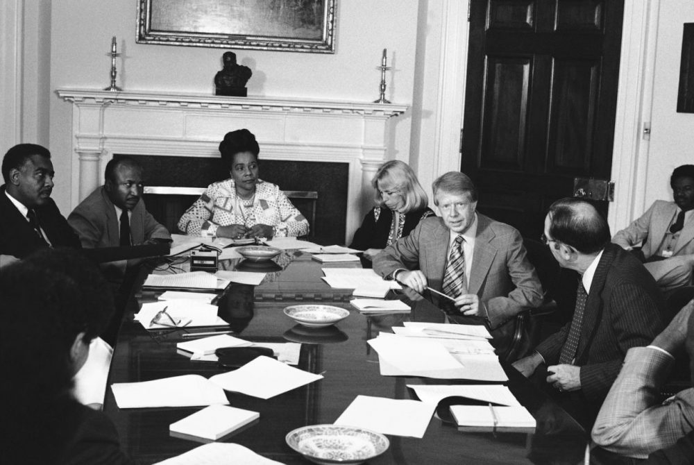 Margaret McKenna began her career as a civil rights lawyer. Here, she's pictured with President Jimmy Carter meeting with his commission for the appointment of blacks to the federal judiciary in the fifth circuit at the White House in 1977. From left: Horace Tate, Georgia state senator; Joe Reid; Mrs. Coretta King, widow of Dr. Martin Luther King; Margaret McKenna; Carter; and Attorney General Griffin Bell. (Harvey Georges/AP)