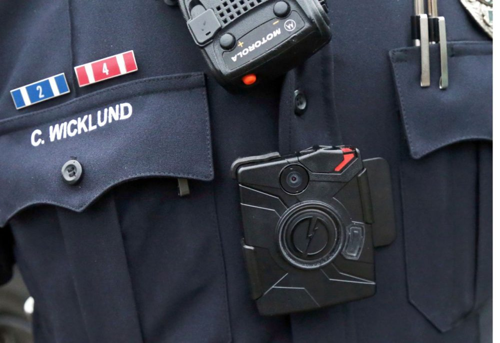 In this Nov. 5, 2014 file photo, a Minnesota police officer wears a body camera.  Police in Lowell are considering a 30-day pilot of the technology. (Jim Mone/AP/File)