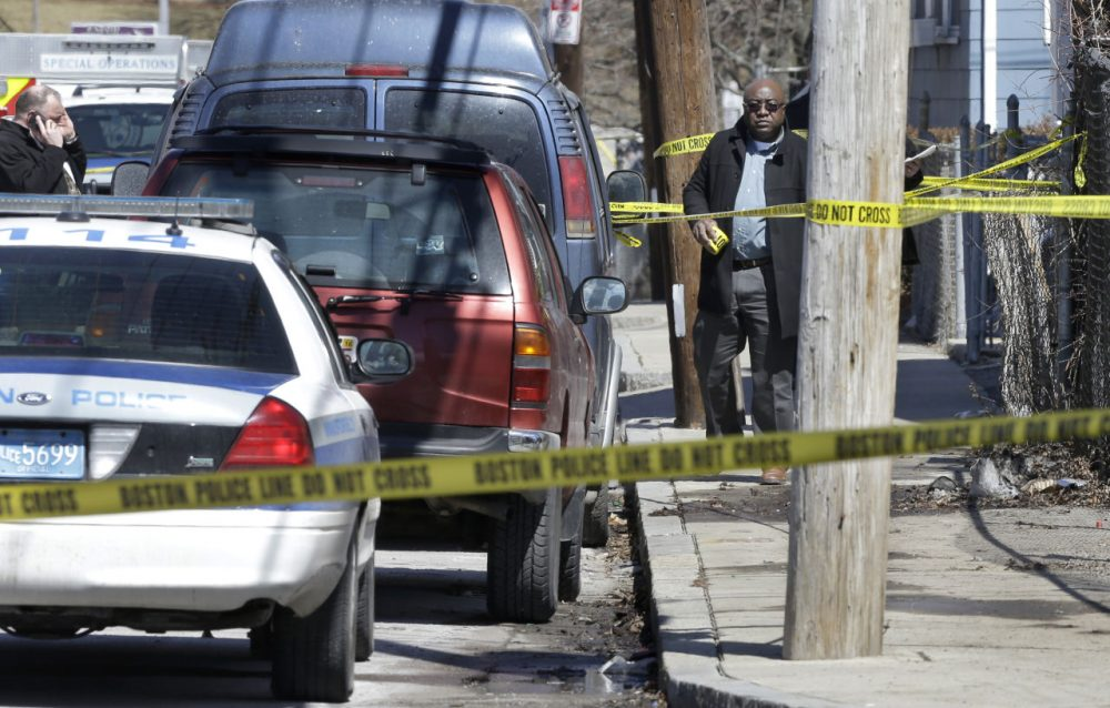 Police tape near a three-story home that was the scene of a fatal shooting in Dorchester in March. (Steven Senne/AP)