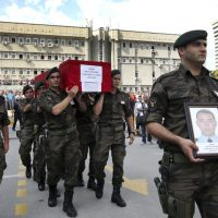 Turkish police officers carry the coffin of Turkish police special operations officer Sahin Polat Aydin, one of the four officers killed Monday in a landmine attack attributed to militants of the Kurdistan Workers' Party, or PKK, in Silopi, southeastern Turkey, during a ceremony in Ankara, Tuesday, Aug. 11, 2015. (AP)