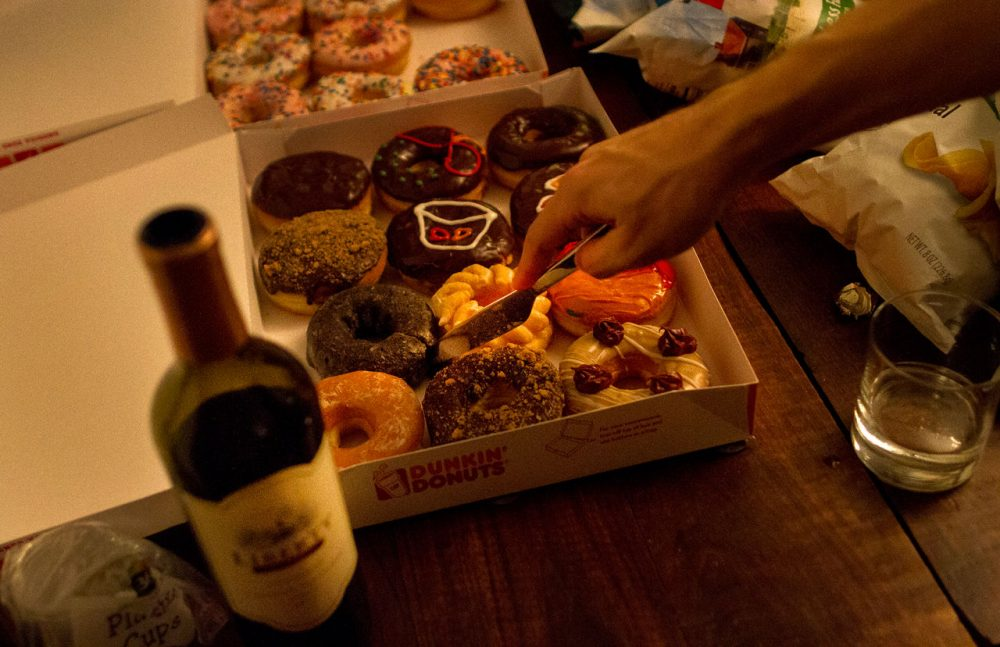 Red wine and donuts at a Groupmuse party in Somerville. (Hadley Green for WBUR)